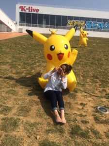Jamin Valdivia in South Korea with a pikachu