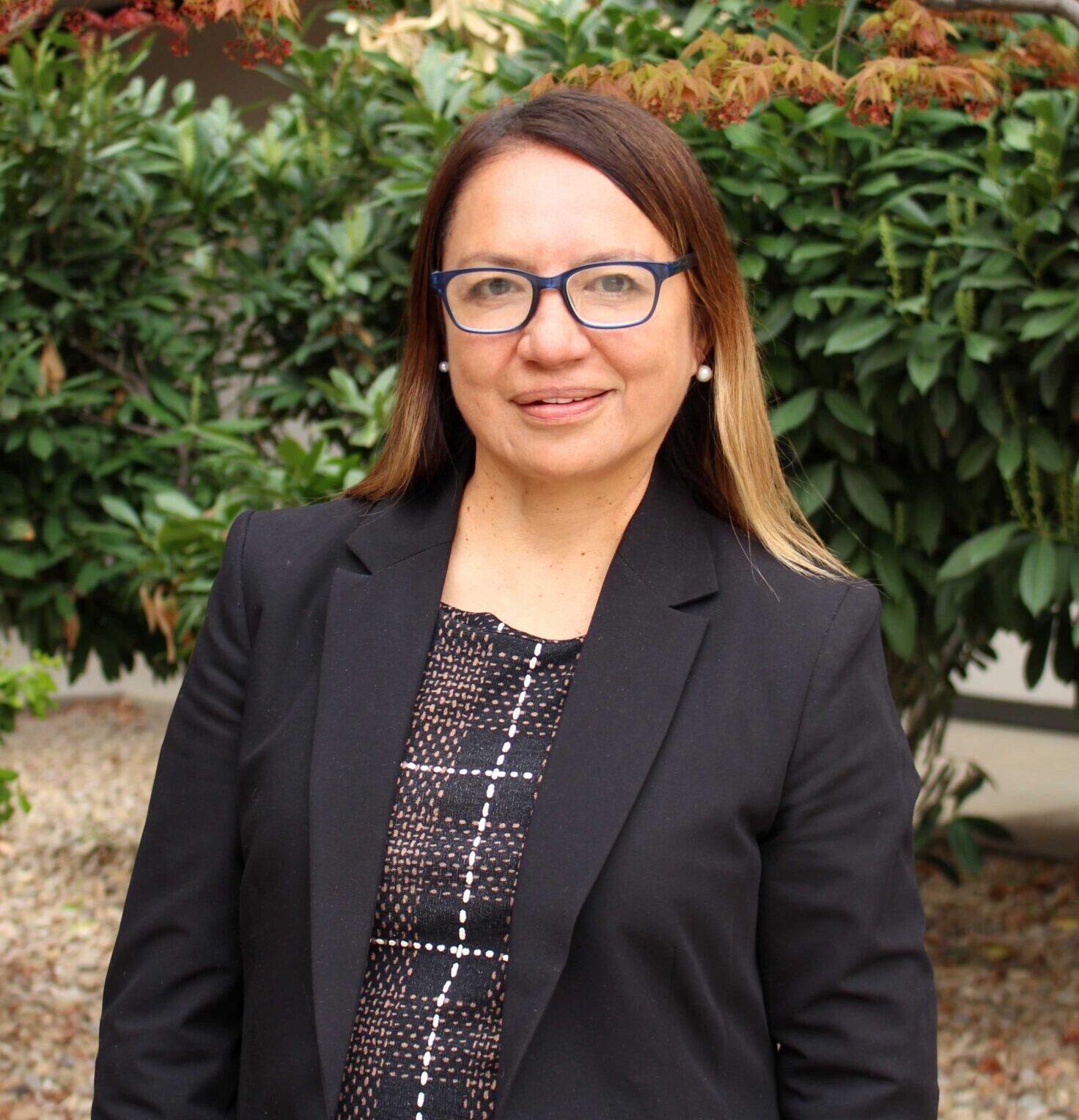 Legal cordinator Giovanna palacios headshot infront of trees